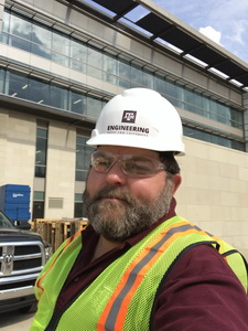 Mike touring construction of new Zachry Engineering Building